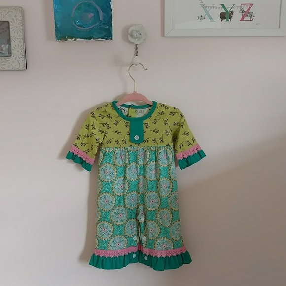 Flit and Flutter Other - Baby printed lace and ruffle romper.